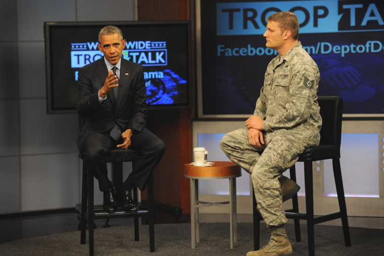 President Barack Obama sits with Air Force Tech Sgt. Nathan Parry, the moderator of the president's worldwide troop talk, on a set from Fort Meade, Md., Sept. 11, 2015. DoD photo by Marvin Lynchard.
