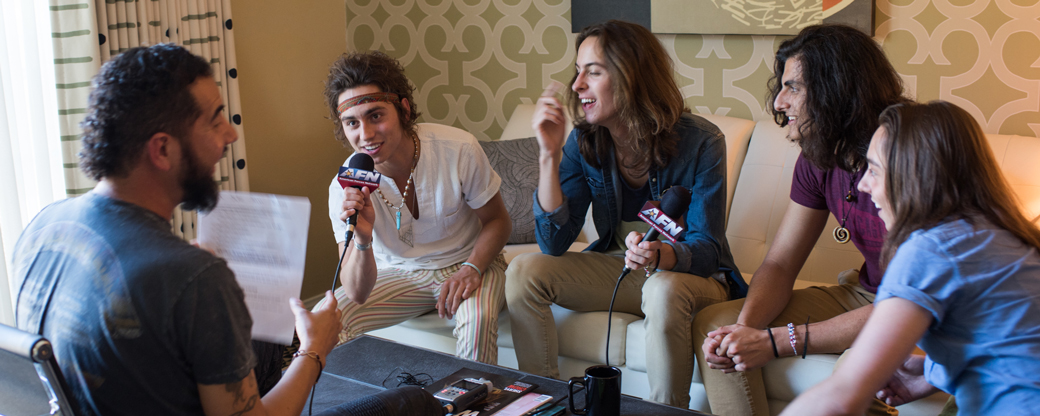 Angel Orozco (broadcaster for AFN Radio) interviewing Greta Van Fleet.